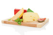 Colorful cheese assortment on chopping board.
