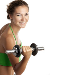 Cute fitness girl working out with dumbbells over white