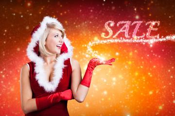 Weihnachtsfrau mit magischem Sale-Sternchenlicht