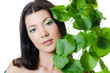 Beautiful woman with spring green leaves