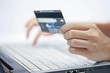 Using a credit card. Online shopping. - 42974302