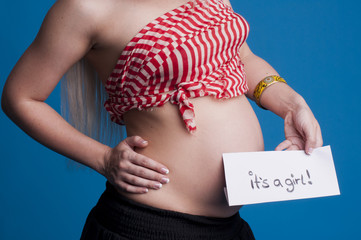 Beautiful pregnant woman expects  baby girl