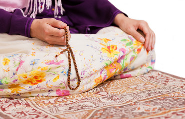Muslim girl praying at mosque