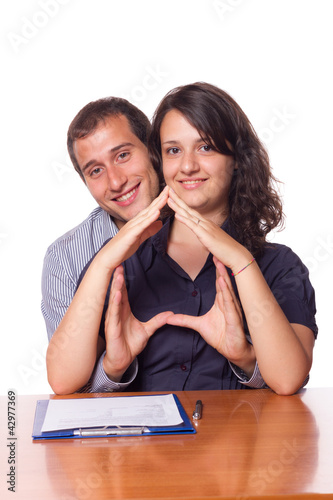 Happy Young Couple Buying an House