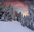 Dramatic winter landscape in the mountains. Sunset