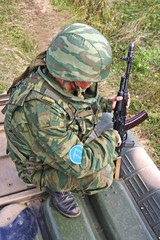Russian soldier on the armored car