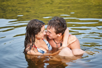 Young couple swimming