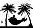 Silhouette of  couple of hammock under the palms on beach