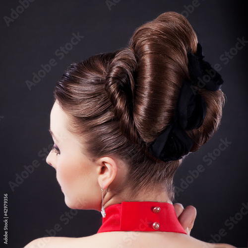 Rear view of a beautiful coiffure. Pigtails. Braid. Backside