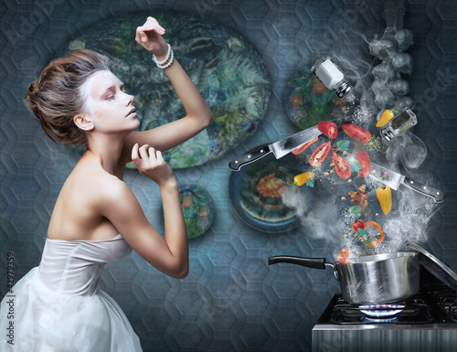 Beautiful emotional woman in kitchen interior cooking. Art