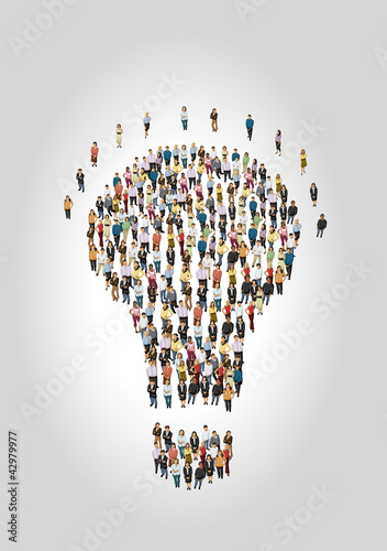 Group of business people in shape of light bulb idea
