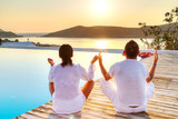 Couple meditating together at sunrise in Greece