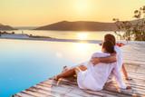 Couple in hug watching sunrise together - Fine Art prints