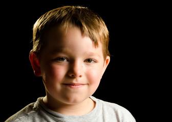 Portrait of mischievous smirking child