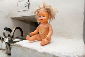 old doll in the oven