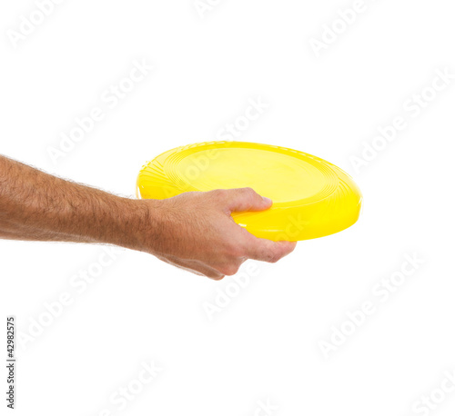 Closeup on flying disc in male hand isolated on white
