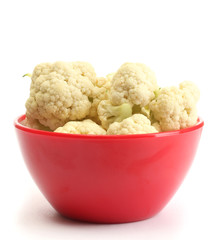 Fresh cauliflower in bright bowl isolated on white