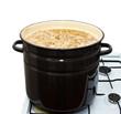 Mushrooms cook in a pan