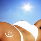 Smiley aus Sonnencreme