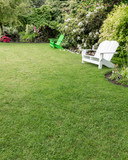 Green lawn with flowers and lawn chairs
