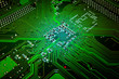 Green glowing computer motherboard abstract background