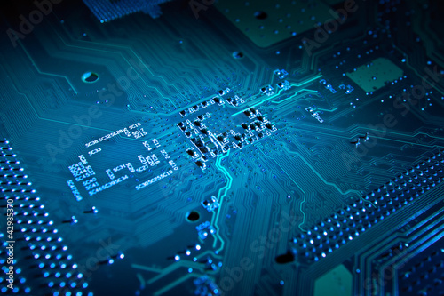 Blue glowing computer motherboard abstract background