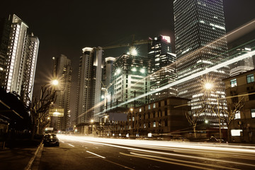 the light trails on the modern building background in shanghai