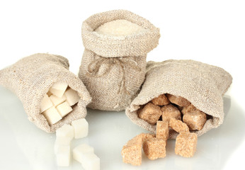 Sack with different types of sugar isolated on white