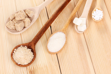 Sweetener with white and brown sugar in spoons