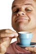 Man smelling his aromatic cup of coffee