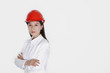 Businesswoman wearing safety helmet