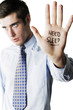 Businessman with the word 'Need Sleep' written on his palm