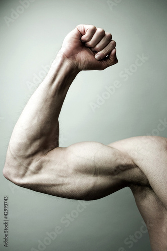 Man flexing his muscle