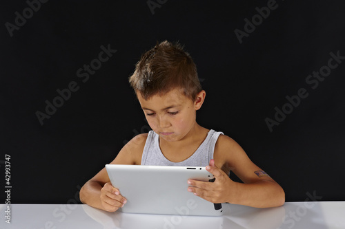 boy holding a tablet