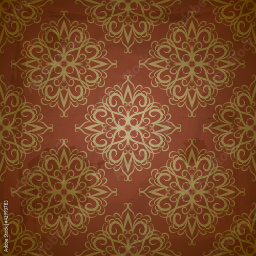 vector seamless golden pattern on red grungy background with cru