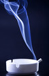 Blue cigarette smoke in black background