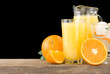 fresh orange fruits juice and slices isolated on black