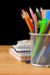 back to school concept and office supplies on black