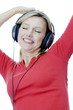 Woman listening to music on the headphones