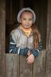 Happy girl-preschooler in wooden hut