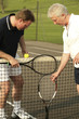 Men with tennis racquet and ball