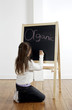 Girl writing on the blackboard