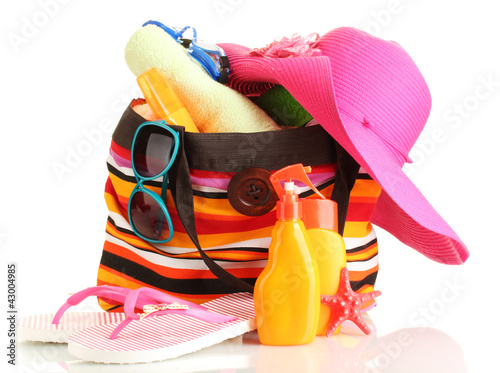 Beach bag with beach accessories, isolated on white