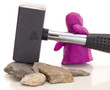 Knetgummifigur mit Hammer / Modelling clay figure with a sledge