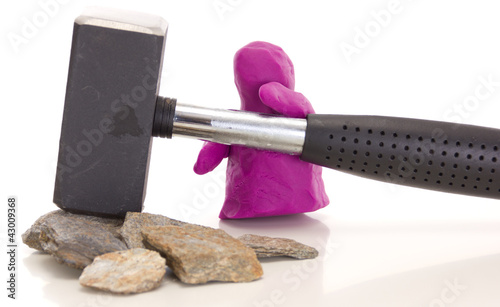Knetgummifigur mit Hammer / Modelling clay with a sledge