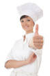 chef woman keeping thumb up, focus on foreground