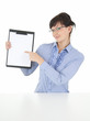 attractive businesswoman showing on clipboard