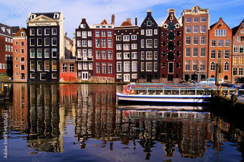 Poster Traditional houses of Amsterdam with canal reflections
