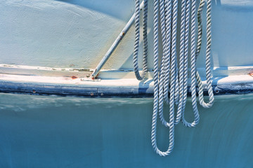 White worn rope hanging from boat