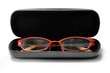 Fashionable orange glasses in a black box isolated on white